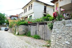 Street with homes in Ohrid, Macedonia. Street view from Ohrid, Macedonia. Private homes and sheds.  Summer day Stock Photos