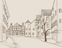 Street view in old european city. Retro cityscape - houses, buildings, tree on alleyway. Stock Images