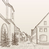 Street view in old european city. Retro cityscape - houses, buildings, tree on alleyway. Stock Photos