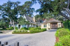 Street view of an old house with a large courtyard in Carmel-by-the-Sea royalty free stock photo