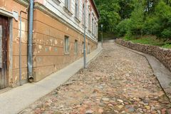 Calm road without people going up. Beautiful small old town Talsi in Latvia in daylight. Street view of old house in Talsi, Latvia.Talsi is administrative stock photo