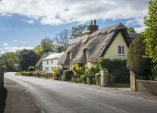 Thatched Cottages in an English Village. Street view of old thatched cottages in the pretty village of Foxton, Cambridgeshire, England, UK royalty free stock images