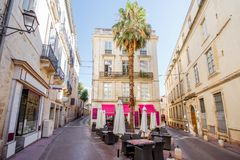 Montpellier city in France. Street view at the old town with cafe terrace in Montpellier city in Occitanie region of France stock image