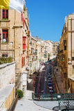 Street view of Old Town, Valletta. Valletta, Malta - March 12 2017: Street view of Old Town with traditional maltese houses and small bridge. Famous touristic Royalty Free Stock Photo
