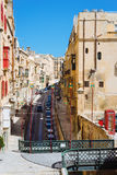Street view of Old Town, Valletta. Valletta, Malta - March 12 2017: Street view of Old Town with traditional maltese houses and small bridge. Famous touristic Royalty Free Stock Images