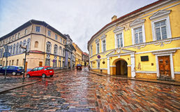Street view in the Old Town of Vilnius in Lithuania in rainy wea Stock Photo