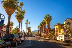 Street view of Palm Springs at sunrise. Palm Springs, California, USA - December 27, 2017 : Scenic street view of Palm Springs at sunrise. It is a desert resort stock photography