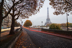 Street view of Paris at dusk. Street view of Paris with the Eiffelt Tower in the background at dusk Royalty Free Stock Images
