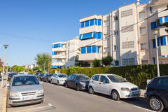 Street view with parked cars. Calafell, Spain Royalty Free Stock Photo
