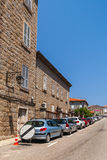 Street view with parked cars. Sartene, Corsica Royalty Free Stock Photo