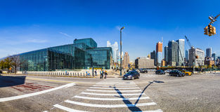 Street view with people in the neighborhood Hells Kitchen  in Ne. NEW YORK, USA - OCT 21, 2015: street view with people in the neighborhood Hells Kitchen  in New Stock Image