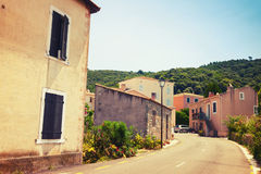 Street view of Piana town in summer. Corsica Stock Photo