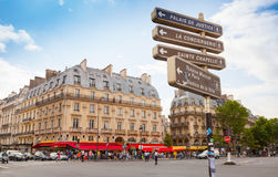 Street view of place Saint-Michel with signpost, Paris Stock Photography