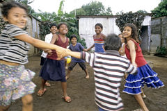 Street view of playing Nicaraguan children. Nicaragua, capital, city Managua: in the poor neighborhood, slum Jorge Dimitrov, boys and girls make a round dance stock photography