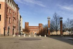 Street view with Porta Palatina, one of the ancient access gates to Turin royalty free stock photos