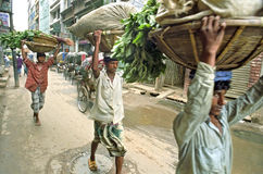 Street view with porters and rickshaws, Dhaka Royalty Free Stock Photos