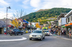 Street view of Queenstown in New Zealand. People can seen exploring around it. Royalty Free Stock Photos