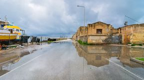Street view with reflection in Marsala, Italy Stock Image
