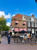 Street view and restaurant facade in Amsterdam stock images