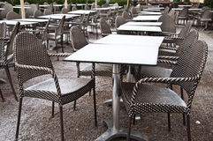 Street view of restaurant terrace with tables and chairs with sn Royalty Free Stock Images