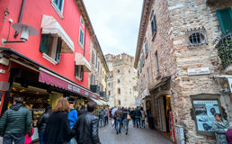Street view with shops and tourists in Sirmione, Italy Stock Image