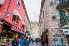 Street view with shops and tourists in Sirmione, Italy Royalty Free Stock Photo