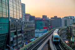 Street view of Taipei with metro train approaching Xihu Station Royalty Free Stock Photos