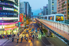 Street view of Taipei with metro train approaching Zhongxiao Fuxing Station Stock Image
