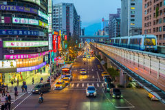 Street view of Taipei with metro train approaching Zhongxiao Fuxing Station Stock Photography