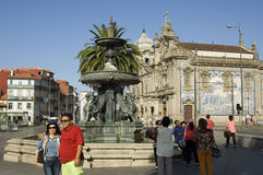 Street view with tourists, fountain and Church Stock Images