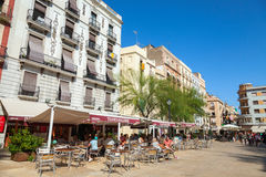 Street view with tourists in the restaurant, Tarragona, Spain Stock Photos