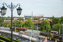 Street view trains in front of Warsaw Poland National Stadium 2012 football championship background stock images