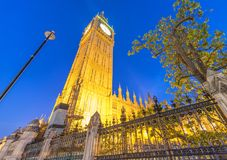 Street view of Westminster Palace at night in London - UK Stock Photo