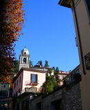 Street in the village of Bellagio, Italy on Como lake. With church cupola stock photo