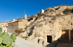 Street at village with dwelling  houses into rocks Stock Photo