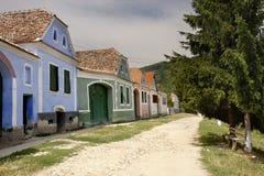 Street of a village in Transylvania. Street of a village with traditional Transylvanian Saxons houses Stock Photos