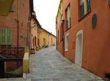 Street of villefranche sur mer. Colorful street in villefranche sur mer of french riviera in winter sky Stock Photo