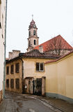 A street of Vilnius and the old church. The old city of Vilnius to chat, lane and the old church Stock Images