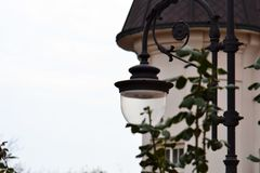 Street lamp in the background of the castle stock photography