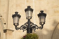 Street Vintage Lantern on a Stone Wall background of a Bulding in Spain, close-up stock photos