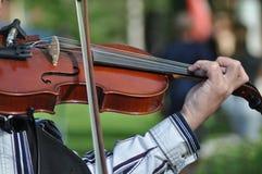 Street Violin. Man who play violin on the street Royalty Free Stock Image