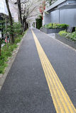 Street of walkway in the business district downtown Tokyo. Royalty Free Stock Photo
