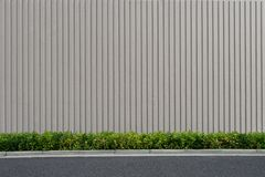 Street wall background ,Industrial background,. Empty grunge urban street with warehouse brick wall stock photography