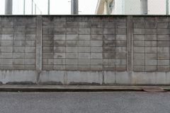 Street wall background ,Industrial background,. Empty grunge urban street with warehouse brick wall royalty free stock photography