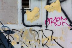Street wall. Graffity tags, some streetart. Illegality Stock Photography