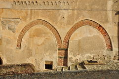 Street wall with renaissance arches remains Royalty Free Stock Images
