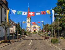 Street in Wallisellen, decorated with flags Stock Photography