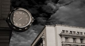 A street watch. This watch has seen so many things and still goes on measuring the time Royalty Free Stock Photo