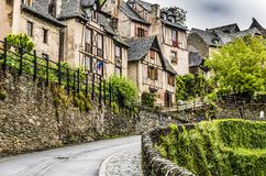 Street on the way up in the beautiful village of Conques. Located on the route of Santiago de Compostela in France we find this medieval village Conques out of stock image