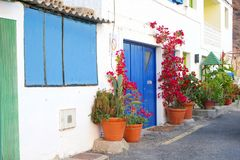 Street houses blue doors flowerpots Bougainvillea, Canary Islands Royalty Free Stock Image